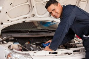 Photo of an Auto Technician Performing Car Repairs