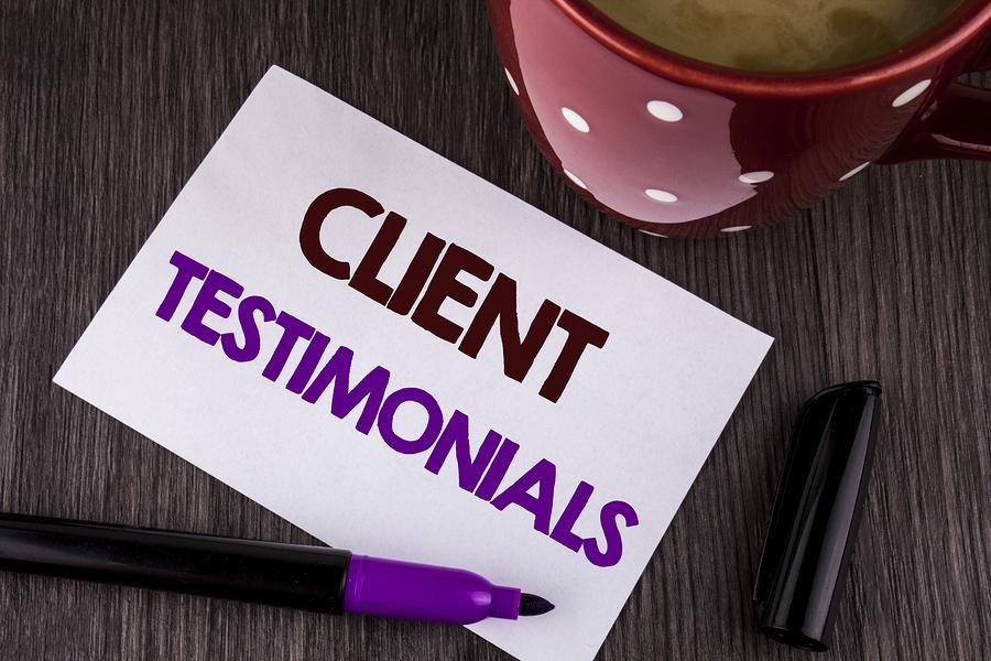 Client Testimonials written on a piece of paper